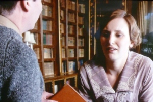Lady Edith Crawley (played by Laura Carmichael) in the Downton's Library. Downton Abbey (2010-2015) Carnival Film & Television in co-production with Masterpiece Theatre. http://www.itv.com/downtonabbey
